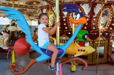Girl ride on carousel