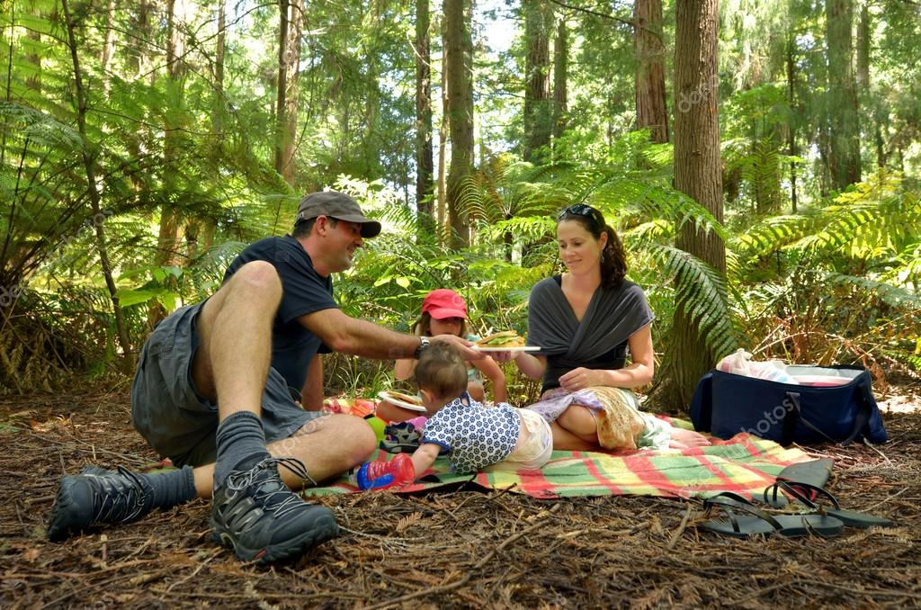 Family having a picnic outdoors in Rotorua