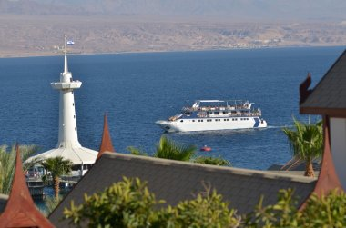 Visitors on a glass boat on Coral Beach Nature Reserve in Eilat,