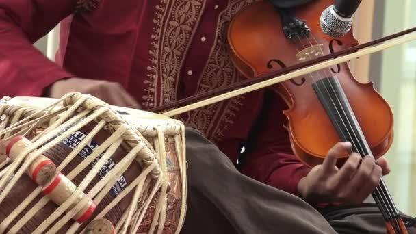 Indian man playing on Violin