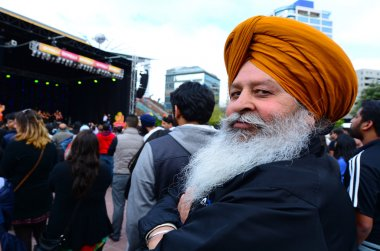 Mature Indian man celebrating Diwali festival in Auckland,New Ze