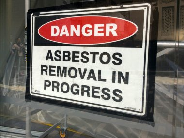 Sign reads: Danger - Asbestos removal in progress