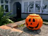 Photo Halloween pumpkin on house front
