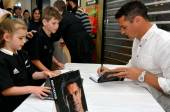 Dan Carter signing copies of his book