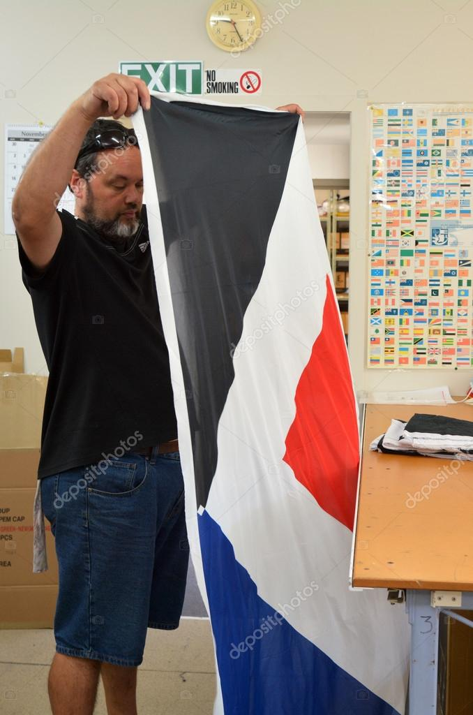 Worker fold the Red Peak flag