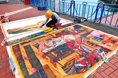 Street artist drawing on the floor Street painting