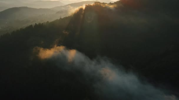 Amazing inspirational epic drone shot thick fog above mountain tops in sunny morning rays. High peaks wonderful morning sunrise natural Landscape. Wild nature life exploring concept