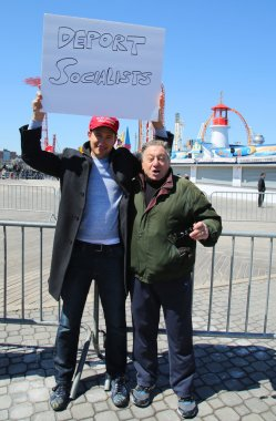 Donald Trump supporters protest against presidential candidate Bernie Sanders during his rally at iconic Coney Island boardwalk in Brooklyn