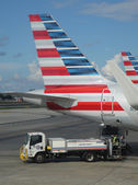 American Airlines worker removing lavatory waste at Miami International Airport