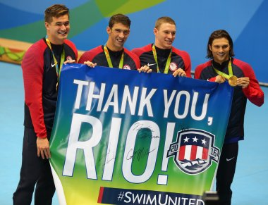 USA Men's 4x100m medley relay team Nathan Adrian(L),  Michael Phelps, Ryan Murphy and Cory Miller celebrate victory
