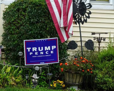 OCEANSIDE, NEW YORK - OCTOBER 20, 2020: Trump Pence 2020 lawn sign on display in Long Island, New York