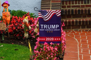 OCEANSIDE, NEW YORK - OCTOBER 20, 2020: Trump Keep America Great  2020 lawn sign on display in Long Island, New York