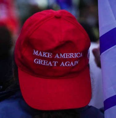 BROOKLYN, NEW YORK - OCTOBER 25, 2020: President Trump supporter wears Make America Great Again hat. President Trump supporters participate at New York for Trump 2020 rally in Brooklyn, New York