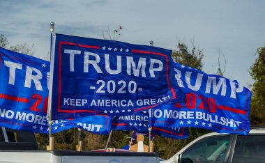BROOKLYN, NEW YORK - NOVEMBER 1, 2020: Flags in support of President Trump at National Trump Day 2020 rally in Brooklyn, New York