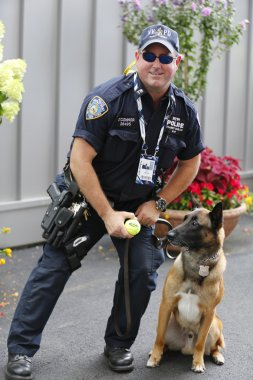 NYPD transit bureau K-9 police officers and Belgian Shepherd K-9 Wyatt  providing security at National Tennis Center during US Open 2014