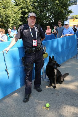 NYPD transit bureau K-9 police officer and Belgian Shepherd K-9 Taylor providing security at National Tennis Center during US Open 2014