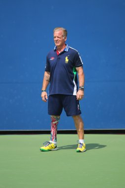 Decorated US Army Veteran Ryan McIntosh with carbon-fiber prosthetic right leg works as US Open ballperson at US Open 2014