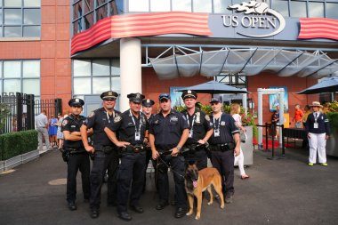NYPD transit bureau K-9 police officers and K-9 dog providing security at National Tennis Center during US Open 2014