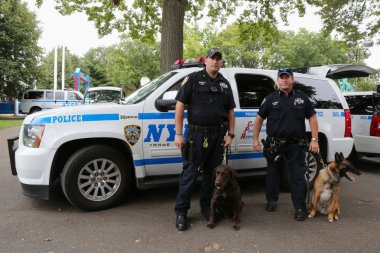 NYPD transit bureau K-9 police officers and K-9 dogs providing security at National Tennis Center during US Open 2014