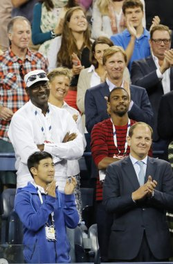 Michael Jordan attends first round match between Roger Federer of Switzerland and Marinko Matosevic of Australia at US Open 2014
