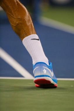Seventeen times Grand Slam champion Roger Federer wears custom Nike tennis shoes during match at US Open 2014