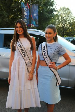 Miss Universe 2014 Gabriela Isler from Venezuela and Miss USA 2014 Nia Sanchez from Nevada at the red carpet before US Open 2014 opening night ceremony
