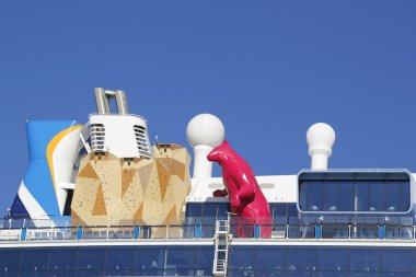 Royal Caribbean Cruise Ship Quantum of the Seas with Lawrence Argent's statue of the Magenta Polar Bear and Rock Climbing Wall