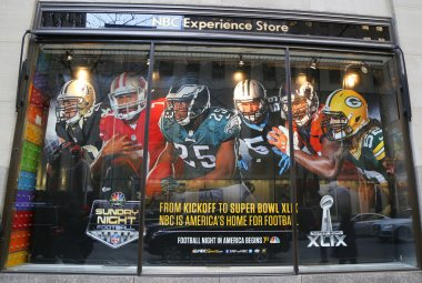 NBC Experience Store window display decorated with NFL and Super Bowl XLIX logos in Rockefeller Center