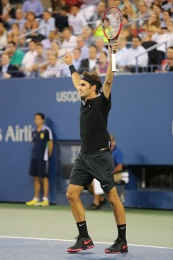 Seventeen times Grand Slam champion Roger Federer celebrates victory after quarterfinal match at US Open 2014