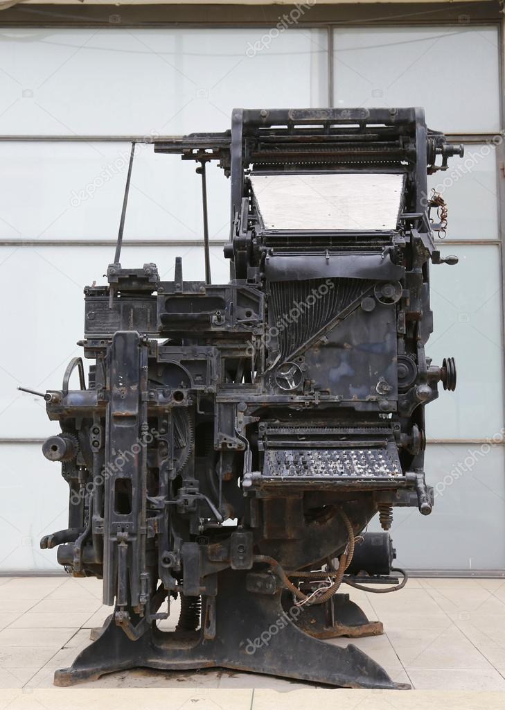 An old printing press machine being exhibited in the