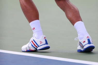 Six times Grand Slam champion Novak Djokovic wears custom Adidas tennis shoes during match at US Open 2014