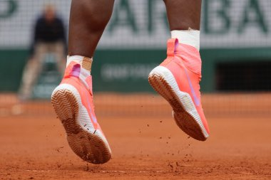 Nineteen times Grand Slam champion Serena Willams wears custom Nike tennis shoes during second round match at Roland Garros