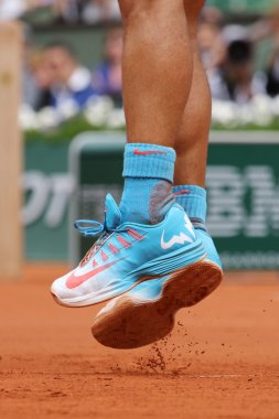 Fourteen times Grand Slam champion Rafael Nadal wears custom Nike tennis shoes during second round match at Roland Garros
