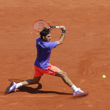 Seventeen times Grand Slam champion Roger Federer in action during his  third round match at Roland Garros 2015
