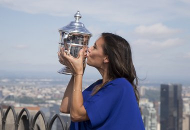 US Open 2015 champion Flavia Pennetta posing with US Open trophy on the Top of the Rock Observation Deck at Rockefeller Center