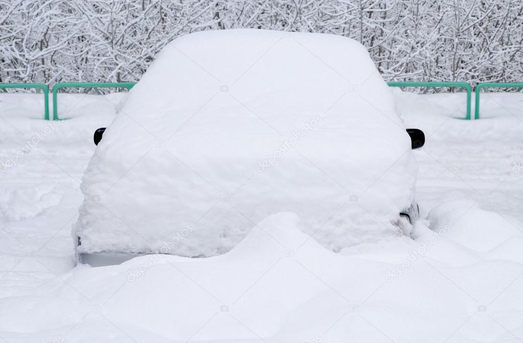 Car under the snow.