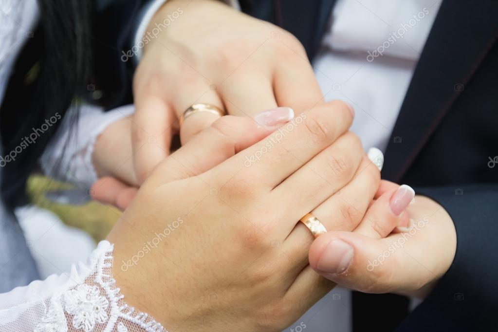Wedding Rings In The Hands Of Men And Women Stock Photo C Macho13