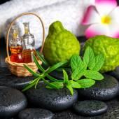 Aromatic concept of bergamot fruits, fresh mint, rosemary, candl
