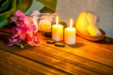 spa concept of pink orchid flower, thai herbal compress balls in