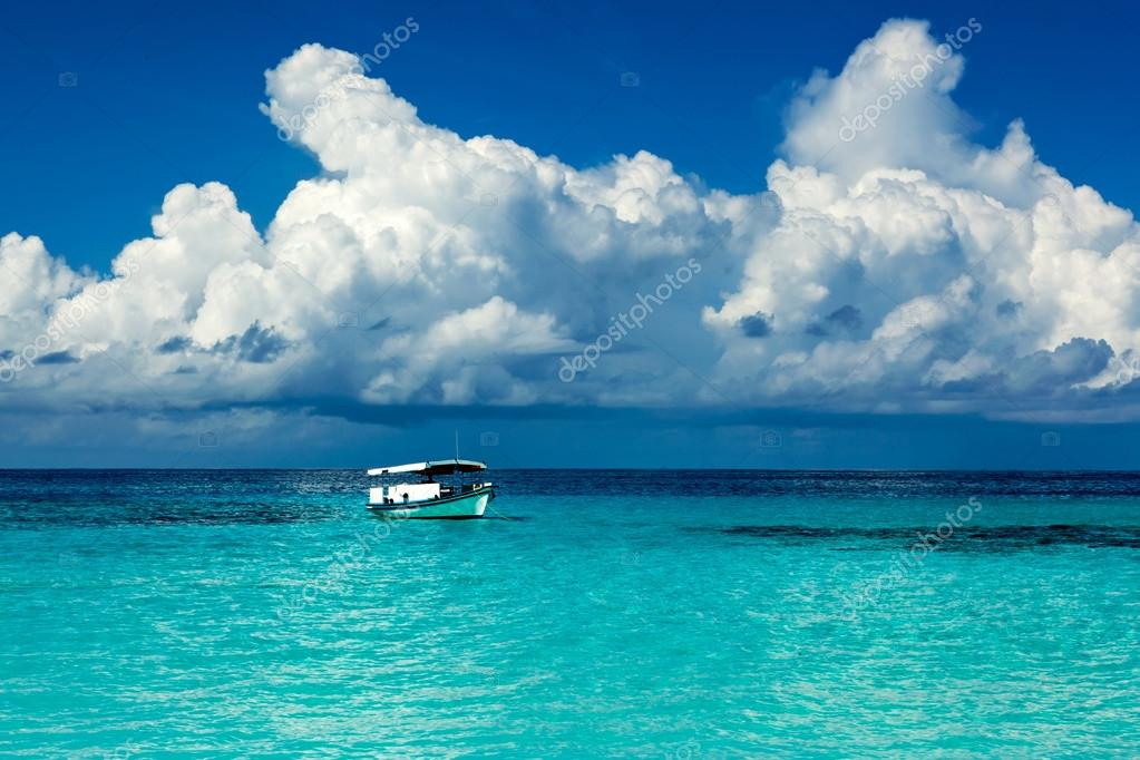 Boat in the lagoon of paradise in the Caribbean