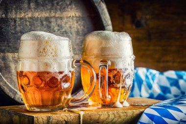 Beer. Oktoberfest.Two cold beers. Draft beer. Draft ale. Golden beer. Golden ale. Two gold beer with froth on top. Draft cold beer in glass jars in pub hotel or restaurant. Still life