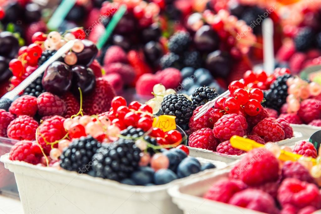 Blueberries, raspberries, strawberries, cherries Forest fruits. Gardening ,agriculture,harvest and forest concept.