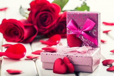 Rose. Red roses.  Bouquet of red roses. Several roses on Granite background. Valentines Day, wedding day background. Rose petals and hearts Valentine gift boxes. Valentines and wedding border. Waters drops on roses petals