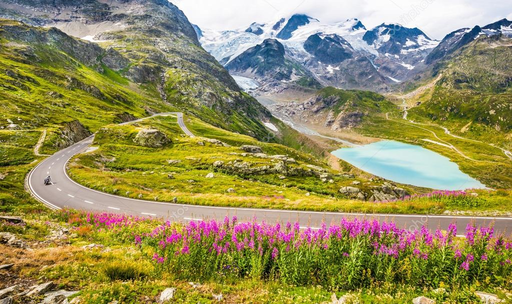 Motorcyclist on mountain pass road in the Alps