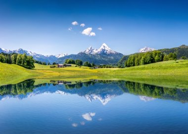Idyllic summer landscape with clear mountain lake in the Alps. stock vector