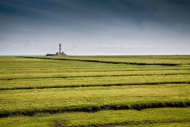 Beautiful landscape with lighthouse at North Sea