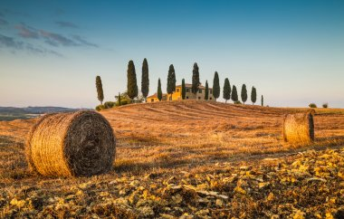 Scenic Tuscany landscape with farm house at sunset, Val d'Orcia, Italy
