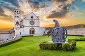 Fotografie Basilica of St. Francis of Assisi at sunset, Umbria, Italy