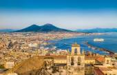 Fotografie City of Napoli (Naples) with Mount Vesuvius at sunset, Campania, Italy