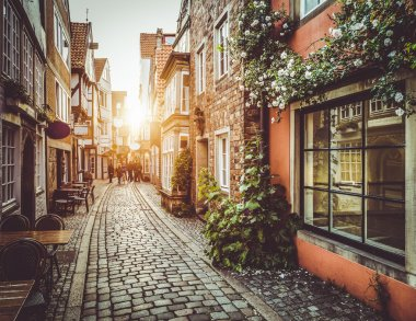 Old town in Europe at sunset with retro vintage Instagram style filter and lens flare effect. stock vector